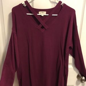 Wine colored top with criss cross at neck